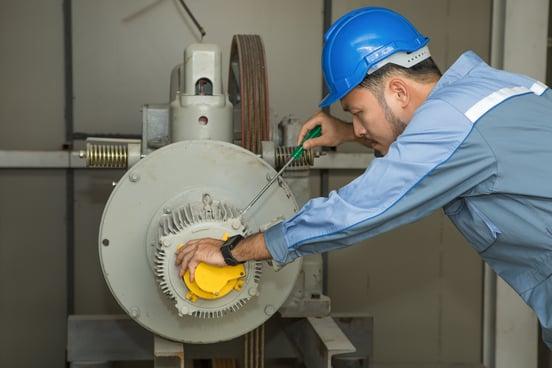 maintenance-engineer-repairing-lift-motor-elevators